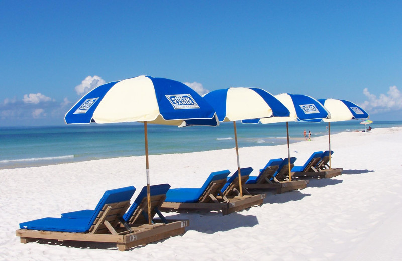 Relaxing by the beach at Sugar Sands Inn & Suites.