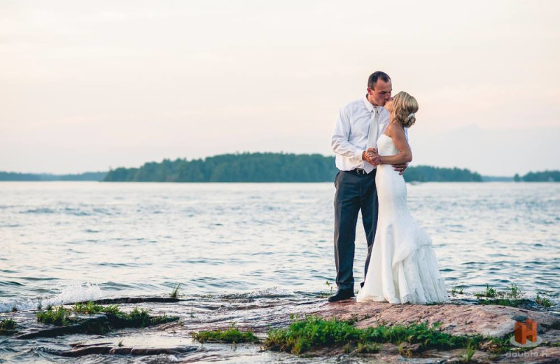 Wedding couple on beach at Bonnie Castle Resort.