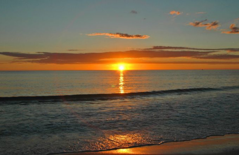 Sunset on the beach at Anna Maria Vacations.