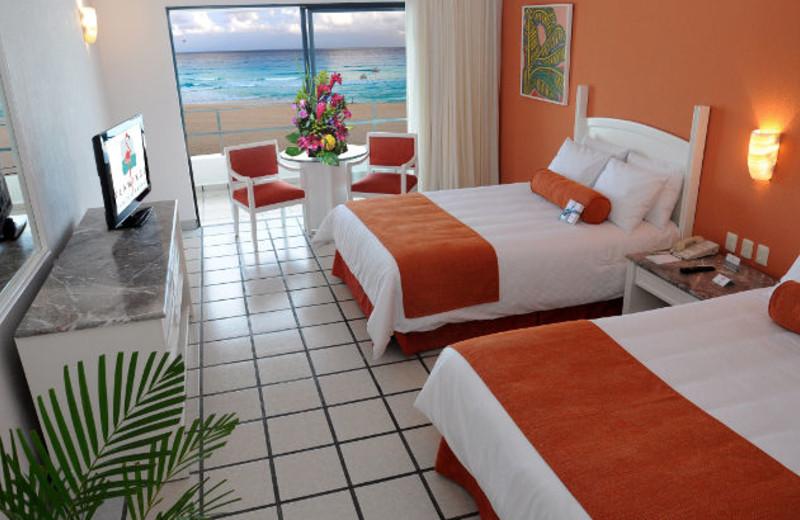 Guest room at Flamingo Cancun Resort & Plaza.