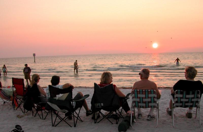 Family on beach at Elliott Beach Rentals.