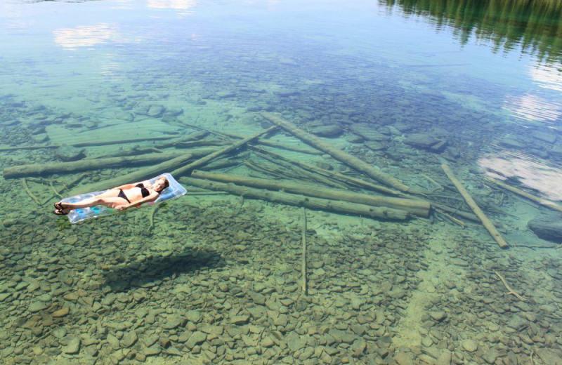 Relaxing in lake at Many Springs Flathead Lake Resort.