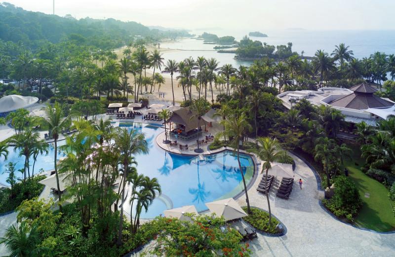 Outdoor pool and beach at Shangri-La's Rasa Sentosa Resort-Singapore.