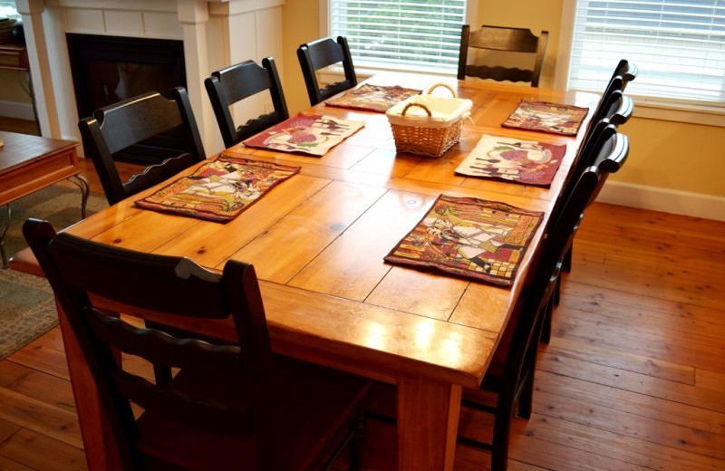 Vacation rental dining table at Bella Beach Property Management.
