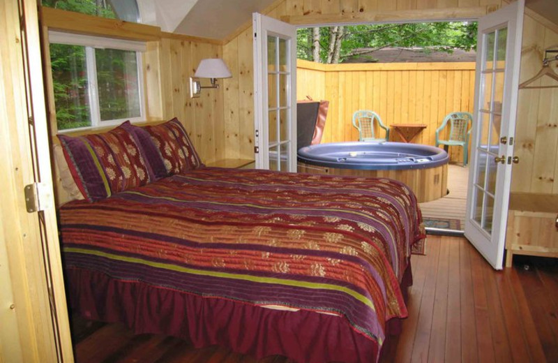 Cabin bedroom at Deep Forest Cabins.