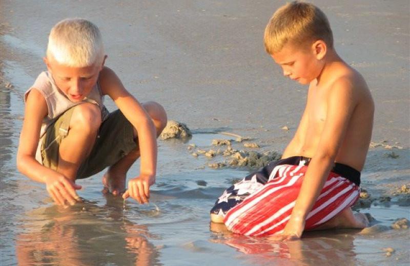 Kids on beach at St. Augustine Ocean & Racquet Resort.