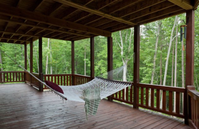 Cabin deck view with hammock at Blue Sky Cabin Rentals.