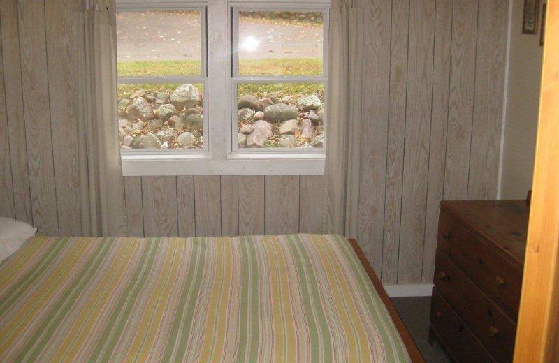 Cabin bedroom at Red Cedar Springs Resort.