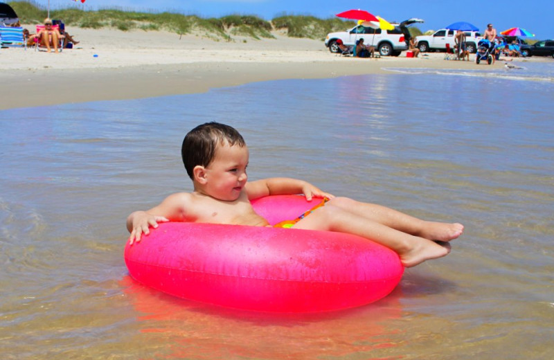 Kid On Tube at Hatteras Realty