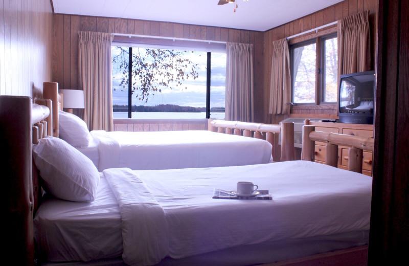 Cabin bedroom at Ruttger's Bay Lake Lodge.