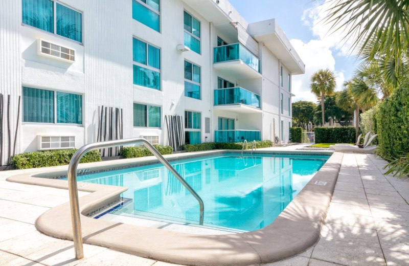 Outdoor pool at Bal Harbour Quarzo Luxury Boutique Hotel.