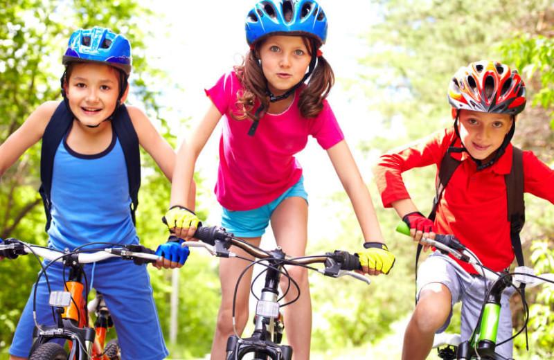 Kids biking at Westgate Branson Woods Resort.