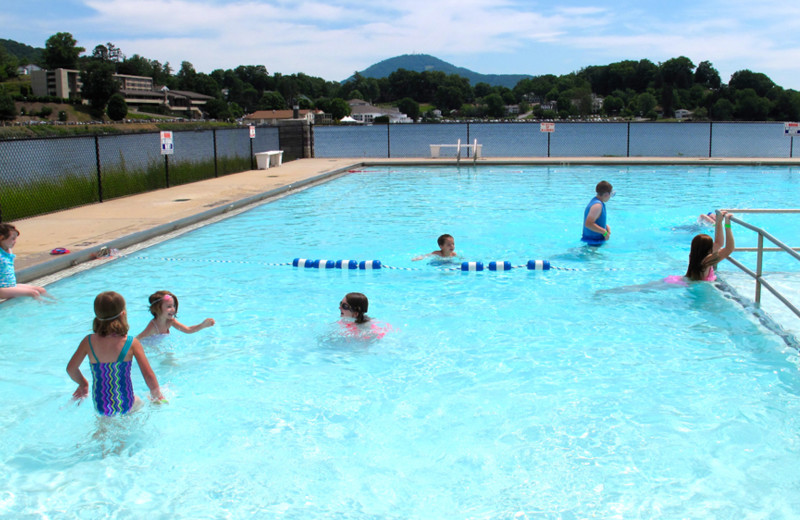 Kids enjoy swimming in the outdoor pool, located nearby The Terrace.