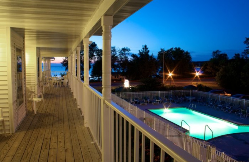 Deck view of outdoor pool at Bay Breeze Resort.
