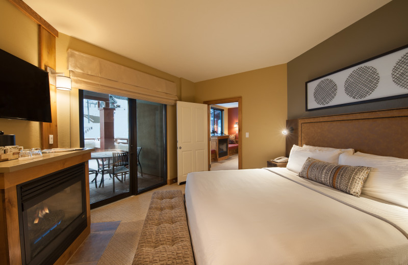 Guest bedroom with fireplace at Grand Summit.