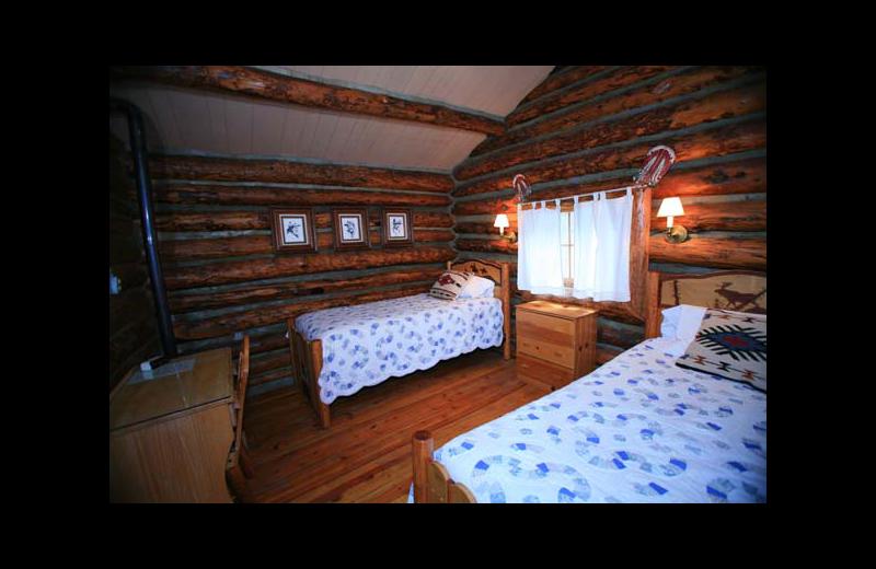 Cabin bedroom at Rimrock Dude Ranch.
