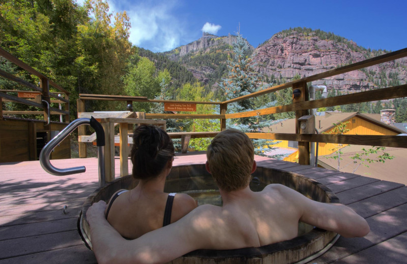 Couple in springs at Box Canyon Lodge & Hot Springs.
