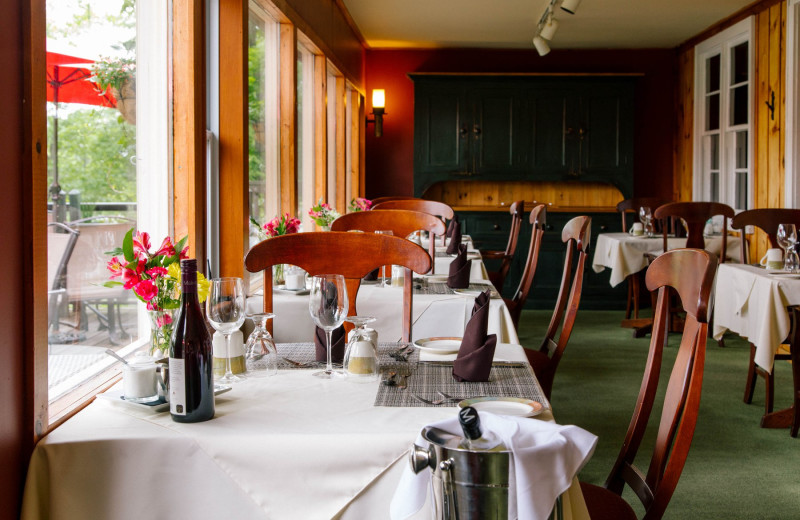 Lake view dining with a four course dinner for a culinary experience at Heather Lodge.