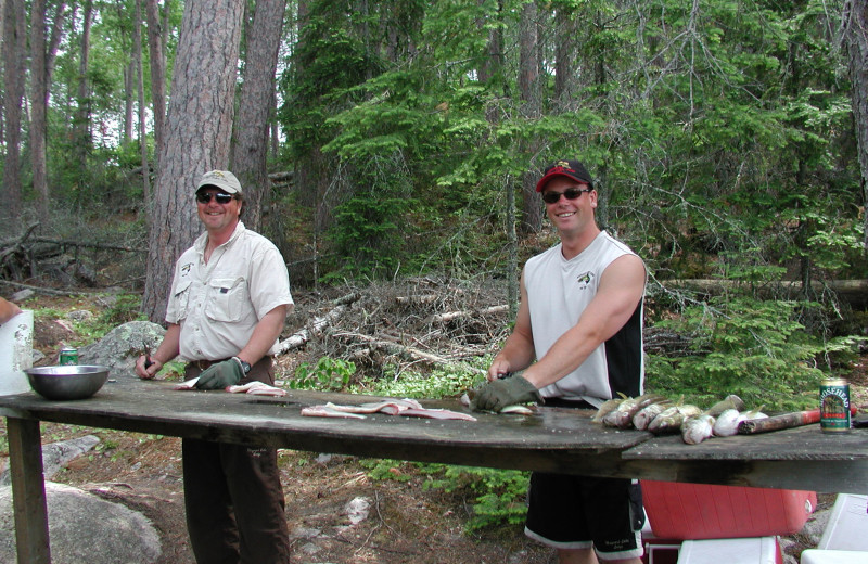 Cleaning fish at Maynard Lake Lodge and Outpost.