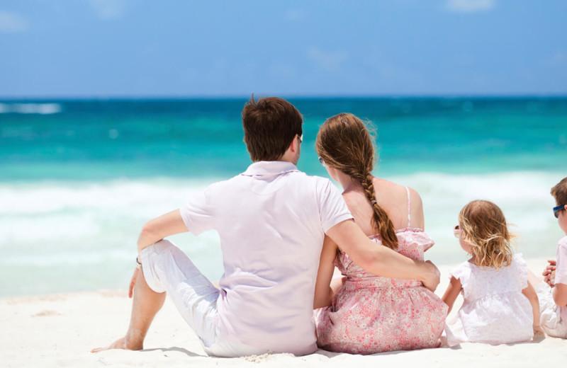 Family on beach at Lake Michigan Reunion & Retreat.
