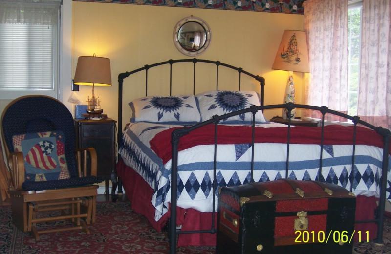 Cottage bedroom at Enchanted Cottages.