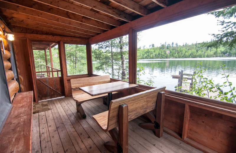 Cabin porch at Clearwater Historic Lodge & Canoe Outfitters.