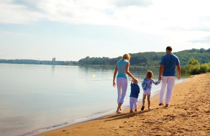 Family walking on beach at Tamarack Lodge.