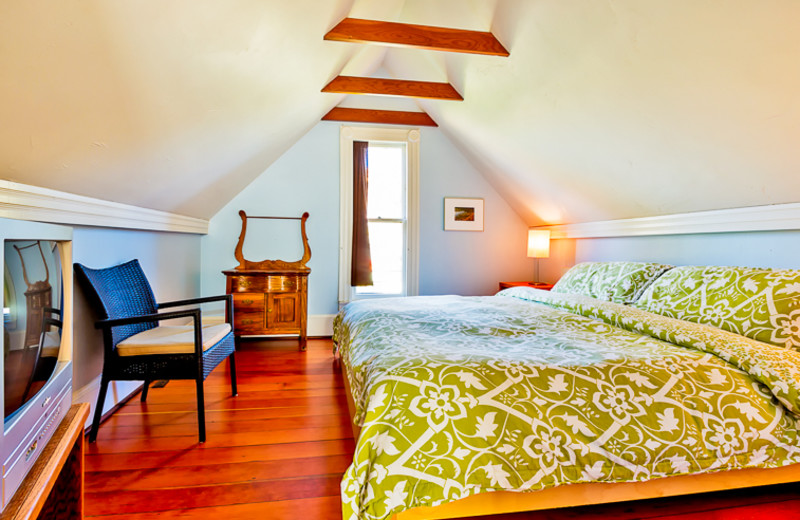 Cottage bedroom at Seabreeze Vacation Rentals, LLC.