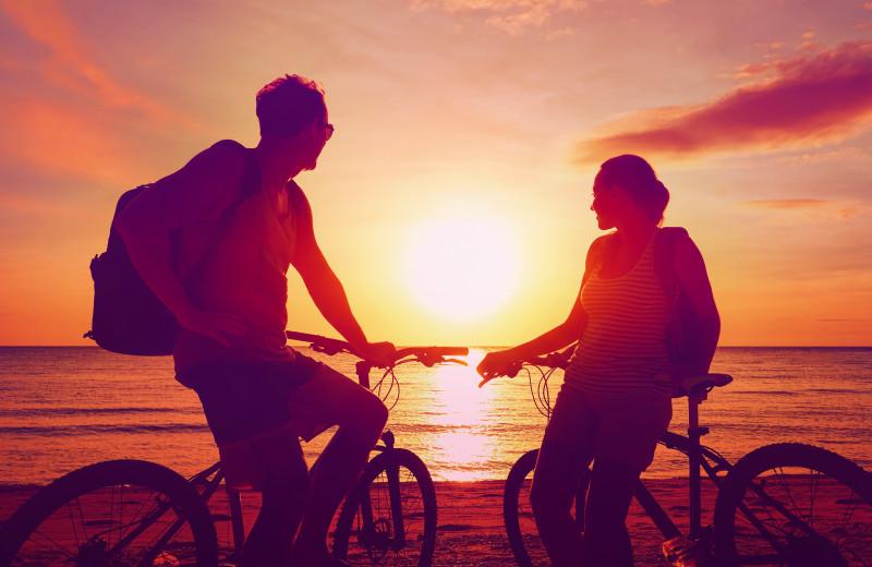 Couple biking at Sea Star Realty.