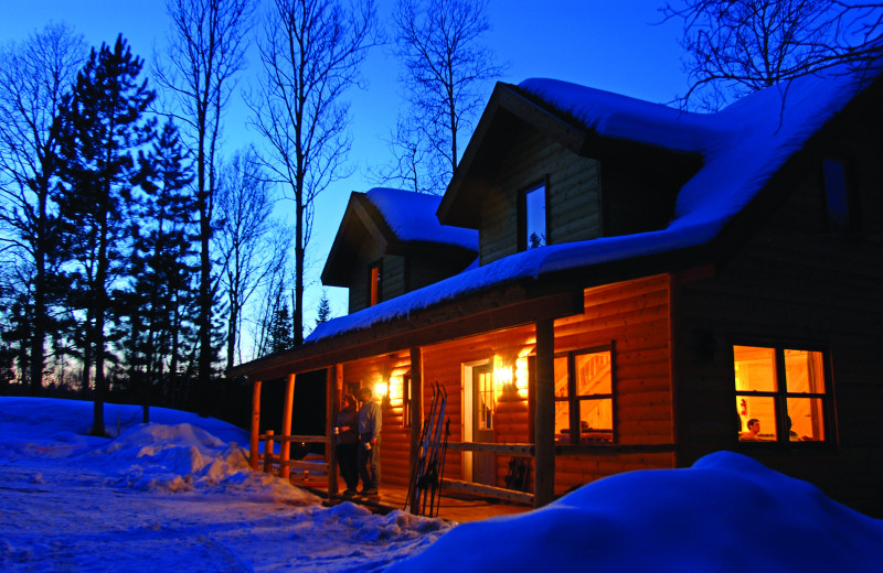 Snow-covered cabin at Timber Trail Lodge & Resort.