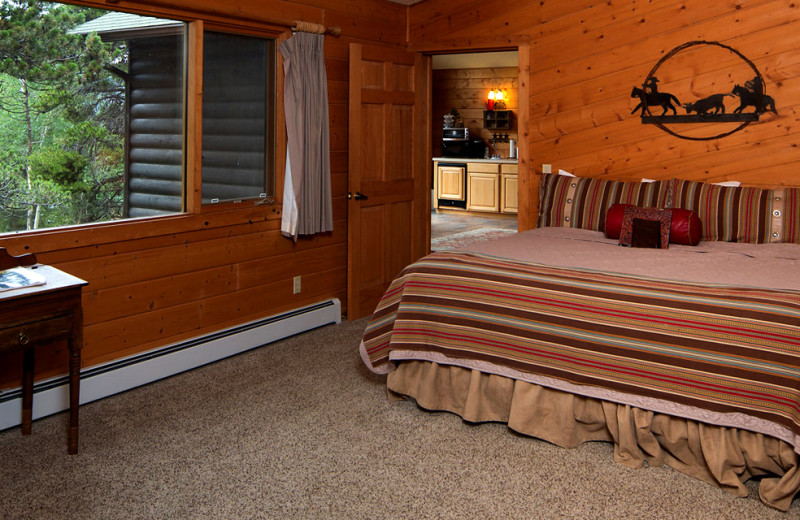 Cabin bedroom at Wind River Ranch.