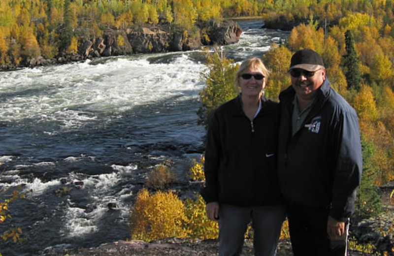 Couple by river at Camp Grayling.