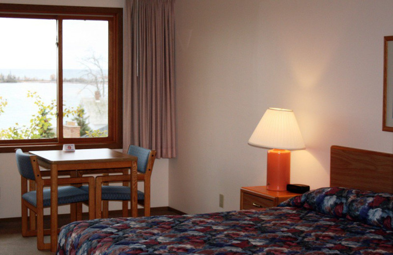 Guest room at Grand Marais Hotel Company.