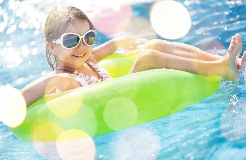 Kid swimming at Bender Realty Vacation Rentals.