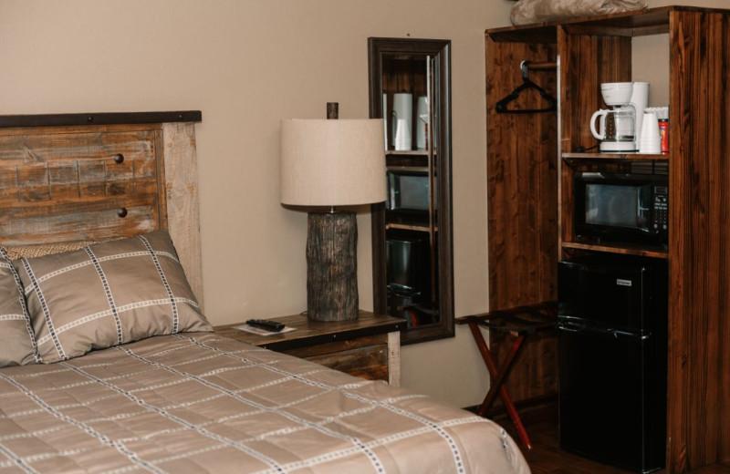 Cabin bedroom at Granite Springs Lodge.