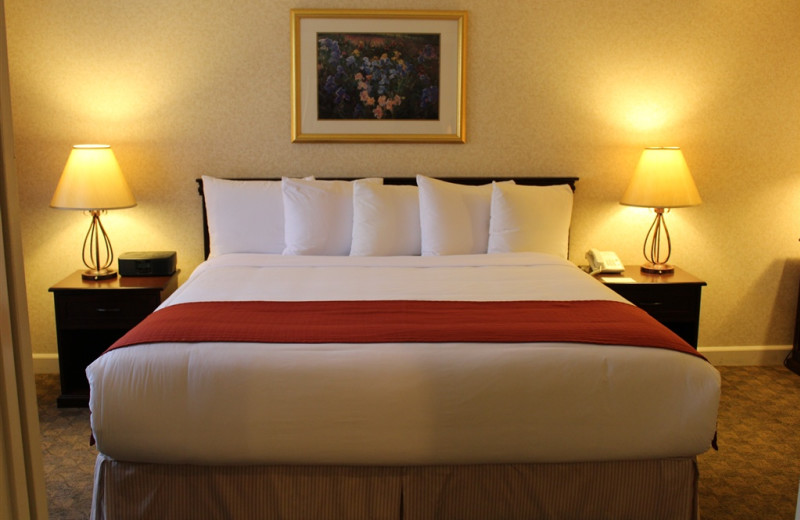 Guest bed at Woodfin Suites Hotel Brea.