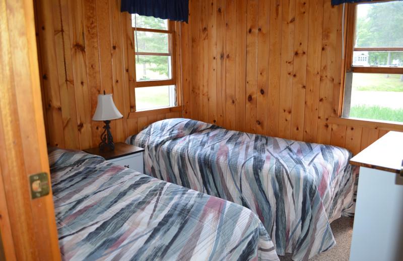 Cabin bedroom at Bay View Lodge.