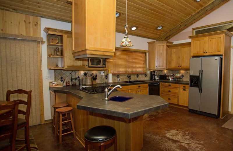 Spacious social kitchen opens to dining and living room. Propane range/oven. OOutdoor BBQ.