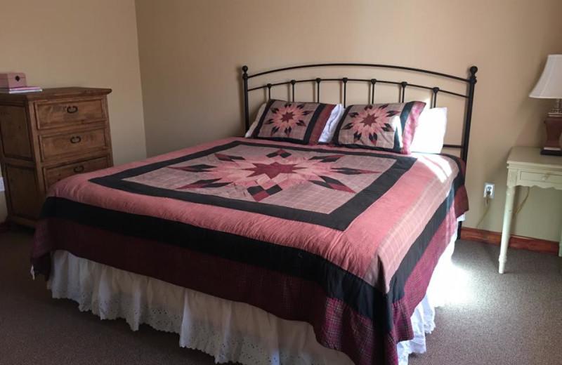 Cottage bedroom at Riverwood Resort.