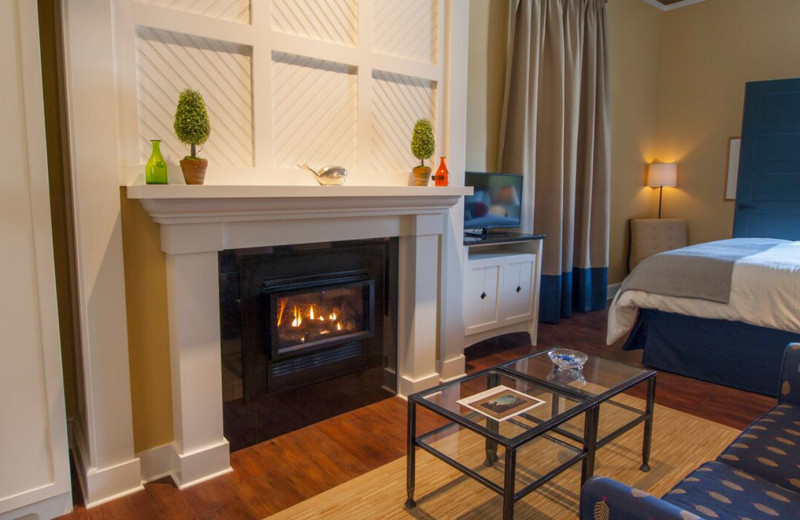 Guest room with fireplace at Inn at Diamond Cove.