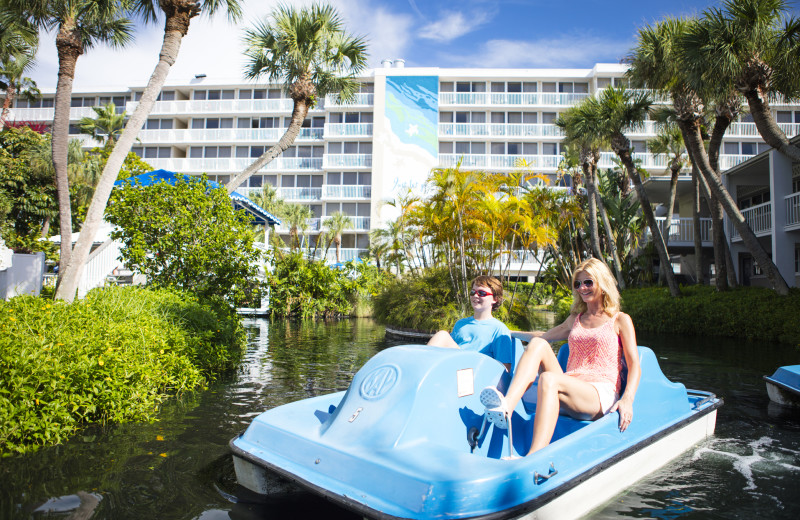 Couple in paddle boat at TradeWinds Island Grand.