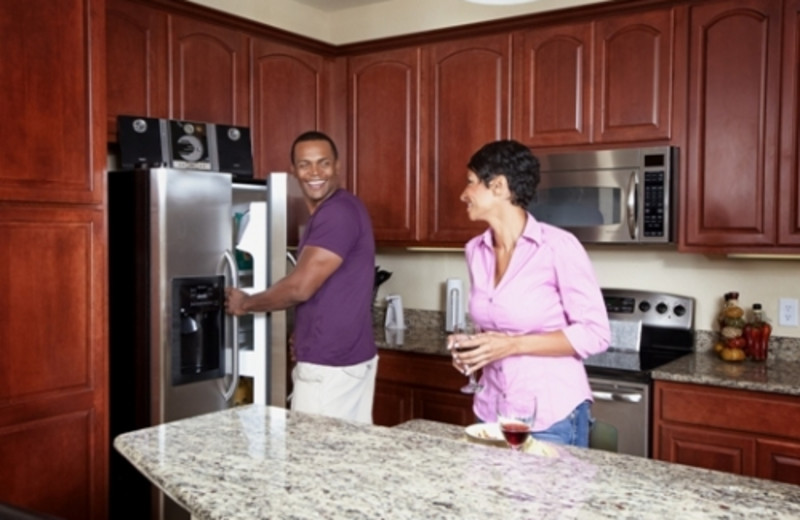 Couple in kitchen at Vista Cay Resort.