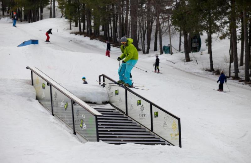 kid Skiing The Rails at Wisp Resort