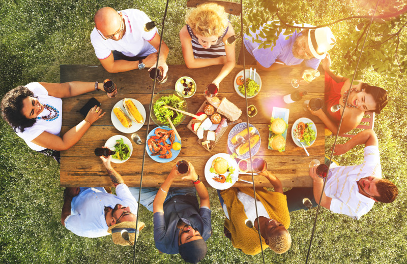 Family & friends getting together over a meal. No matter what the occasion, Ryson Vacation Planners will love to help find the perfect home!