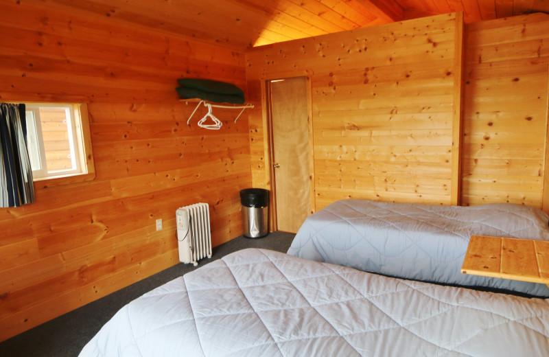 Cabin bedroom at Alaska Trophy Adventures Lodge.