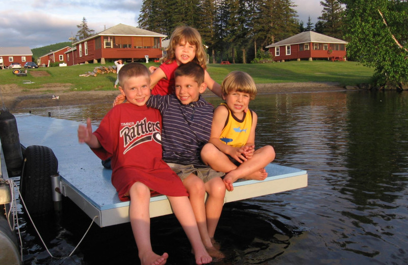 Kids on dock at  Jackson's Lodge and Log Cabins.