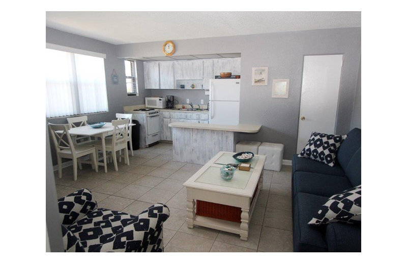 Guest kitchen and living room at Gulf Winds Resort Condominiums.