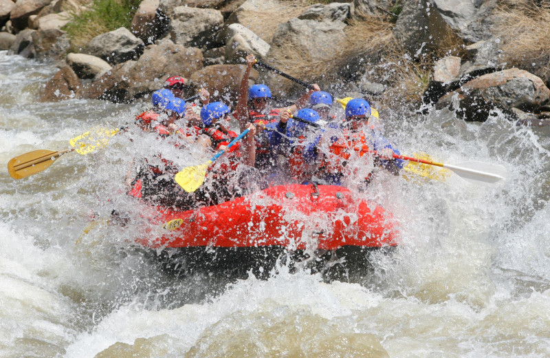 River rafting near Grand Timber Lodge.