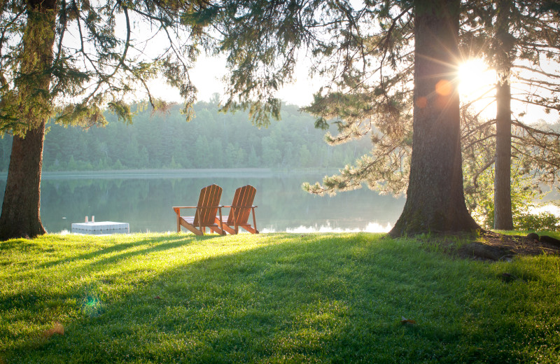 Relaxing in one of the many adirondack chairs overlooking Boot Lake is a perfect way to watch the sunrise or sunset.