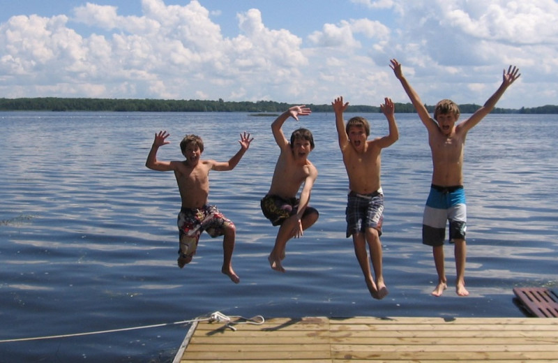 Jumping off dock at Scotsman Point Cottage Resort.